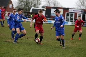 Mickleover's Jake Scott bursts between two Farsley defenders. Picture: Eric Gregory.
